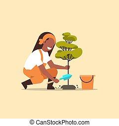 aanplant, vrouw, tuinieren, vrouwlijk, werkende , plat, terrein, afrikaanse boom, jonge, amerikaan, concept, volle, graven, farmer, landbouwkundig, lengte, tuinman, tuin