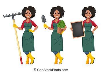 afrikaanse amerikaanse vrouw, tuinman, jonge