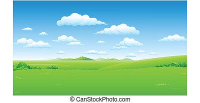 blauwe hemel, groen landschap
