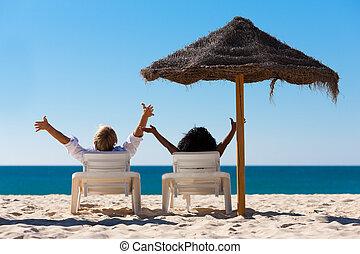 paar, zet op het strand vakantie, sunshade